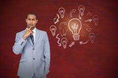 Composite image of thinking businessman. Thinking businessman against image of a desk royalty free stock photo