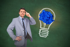 Composite image of thinking businessman. Thinking businessman against green chalkboard stock photos