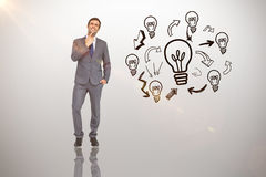 Composite image of thinking businessman. Thinking businessman against idea and innovation graphic stock photo