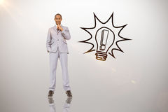 Composite image of thinking businessman. Thinking businessman against idea and innovation graphic royalty free stock photo