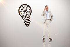 Composite image of thinking businessman. Thinking businessman against idea and innovation graphic royalty free stock image