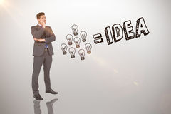 Composite image of thinking businessman. Thinking businessman against idea and innovation graphic stock image