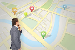 Composite image of thinking businessman. Thinking businessman against map app Royalty Free Stock Image