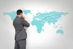 Composite image of thinking businessman. Thinking businessman against world map Stock Image