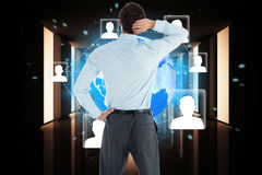 Composite image of thinking businessman with hand on head Stock Photo