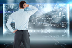 Composite image of thinking businessman with hand on head Stock Image