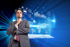 Composite image of thinking businessman holding his glasses Royalty Free Stock Photography