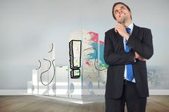 Composite image of thinking businessman holding pen Royalty Free Stock Photography
