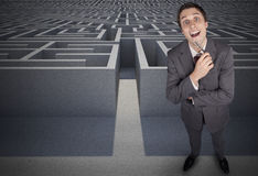 Composite image of thinking businessman holding pen Stock Photography