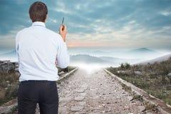 Composite image of thinking businessman holding pen Stock Photos