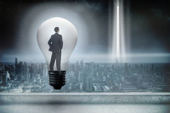 Composite image of thinking businessman in light bulb Royalty Free Stock Photography