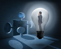 Composite image of thinking businessman in light bulb Stock Image