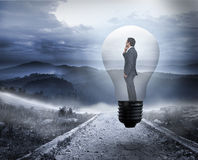 Composite image of thinking businessman in light bulb Royalty Free Stock Photos