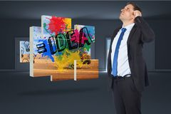 Composite image of thinking businessman scratching head Royalty Free Stock Photo