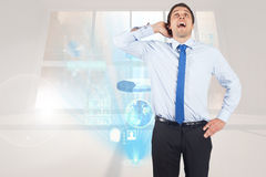 Composite image of thinking businessman scratching head Stock Image