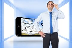 Composite image of thinking businessman tilting glasses Royalty Free Stock Images
