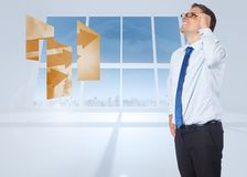 Composite image of thinking businessman tilting glasses Stock Images