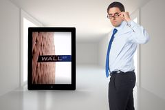 Composite image of thinking businessman tilting glasses Stock Photos