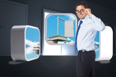 Composite image of thinking businessman tilting glasses Stock Photography