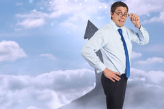 Composite image of thinking businessman tilting glasses Royalty Free Stock Image