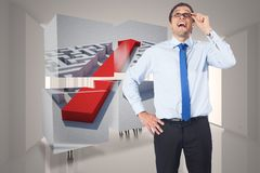Composite image of thinking businessman tilting glasses. Thinking businessman tilting glasses against tiny figures in huge hall Royalty Free Stock Photo