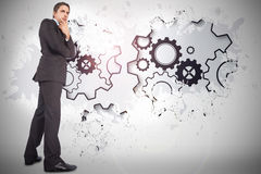 Composite image of thinking businessman touching chin Royalty Free Stock Images