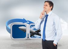 Composite image of thinking businessman touching his chin Royalty Free Stock Images