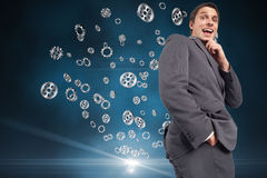 Composite image of thinking businessman touching his chin Royalty Free Stock Photography