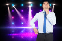 Composite image of thinking businessman touching his chin Royalty Free Stock Image