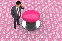 Composite image of thinking businessman touching his glasses. Thinking businessman touching his glasses against pink graphic background Stock Images