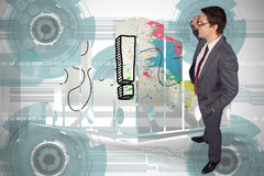 Composite image of thinking businessman touching his glasses. Thinking businessman touching his glasses against technology wheel background Royalty Free Stock Image