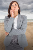 Composite image of thinking businesswoman Royalty Free Stock Photos