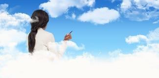 Composite image of thinking businesswoman stock image
