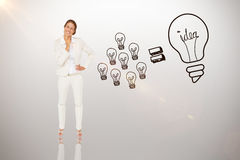 Composite image of thinking businesswoman. Thinking businesswoman against idea and innovation graphic royalty free stock photo