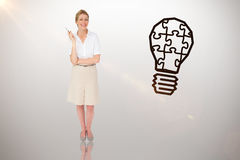 Composite image of thinking businesswoman. Thinking businesswoman against idea and innovation graphic royalty free stock photography