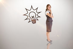 Composite image of thinking businesswoman. Thinking businesswoman against idea and innovation graphic stock photos