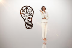 Composite image of thinking businesswoman. Thinking businesswoman against idea and innovation graphic stock images