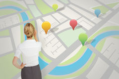 Composite image of thinking businesswoman. Thinking businesswoman against map app Royalty Free Stock Photo