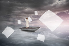 Composite image of thinking businesswoman in a boat Stock Photos