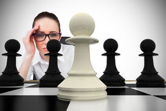 Composite image of thinking businesswoman Royalty Free Stock Image
