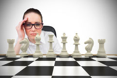 Composite image of thinking businesswoman Stock Photo