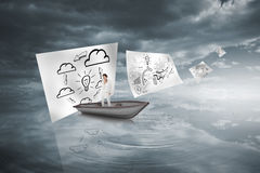 Composite image of thinking businesswoman in a sailboat Royalty Free Stock Photos