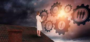 Composite image of thinking businesswoman. Thinking businesswoman against gloomy sky royalty free stock images