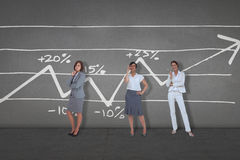 Composite image of thinking businesswomen Royalty Free Stock Photography