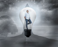 Composite image of thinking man in light bulb Royalty Free Stock Photos