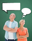 Composite image of thinking older couple with arms crossed. Thinking older couple with arms crossed against green Stock Photos