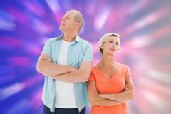 Composite image of thinking older couple with arms crossed Royalty Free Stock Photo
