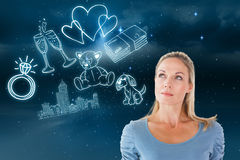 Composite image of thinking pretty blonde looking up Stock Photography