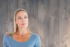 Composite image of thinking pretty blonde looking up Royalty Free Stock Images