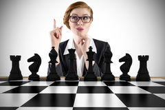 Composite image of thinking redhead businesswoman Stock Photo